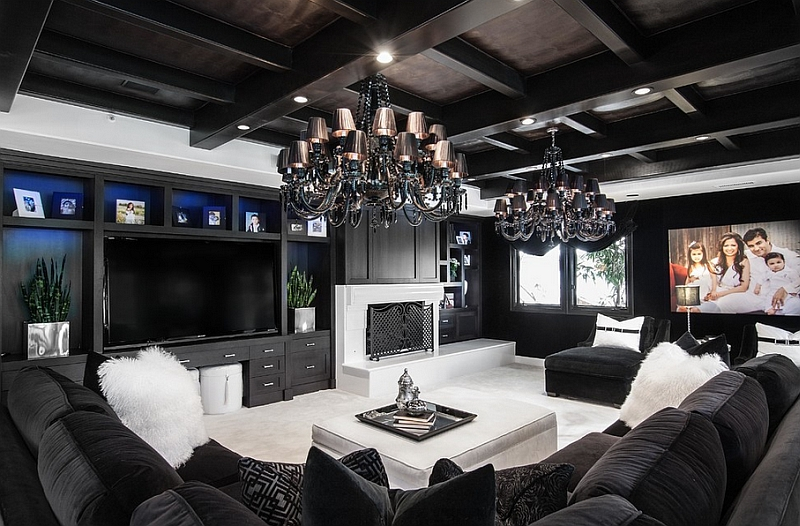 Luxurious contemporary family room in black and white looks truly stunning!