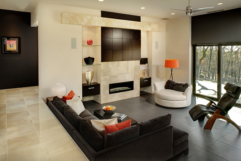 Luxurious decor and bright pops of orange create a cozy step-down living space