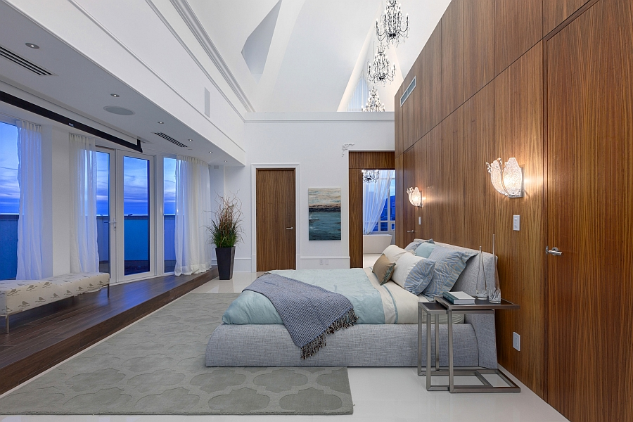 Luxurious master bedroom of the penthouse opens into the terrace outside