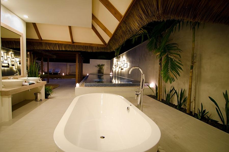Luxurious villas of the Kuramathi Island Resort after sunset