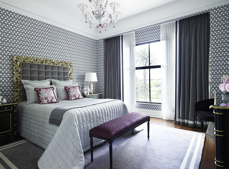 Majestic bedroom in purple and gray with walls draped in David Hicks hexagonal wallaper