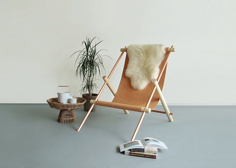 Metal, wood and leather lounge chair