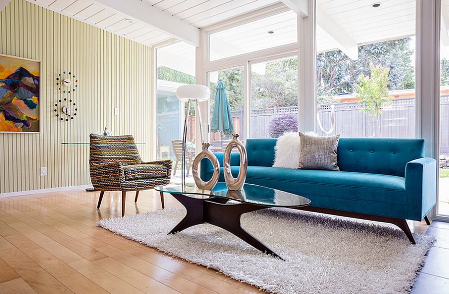 Midcentury family room with a lovely couch in bold blue