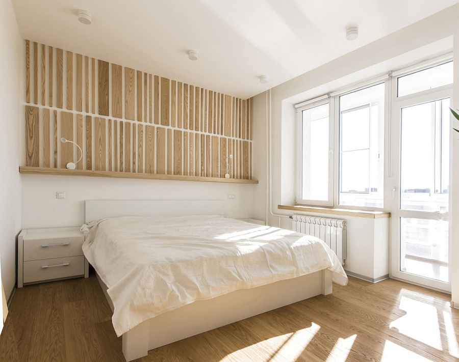 Minimal and luxurious bedroom in white with warm wooden tones