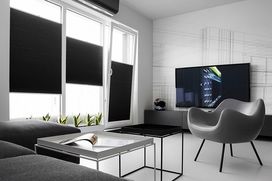 Small black and white apartment in poland exudes refined for Modern minimalist house interior design