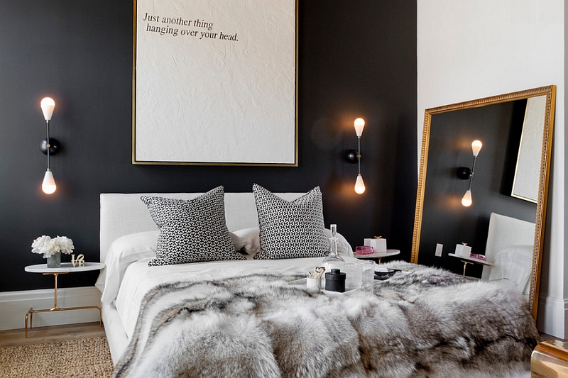 Mirror and lighting give the small bedroom a relaxed appeal despite the use of black