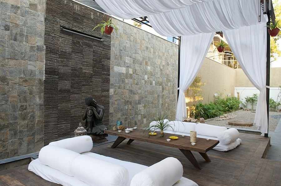 Modern Moroccan-inspired patio combined with breezy tropical touches