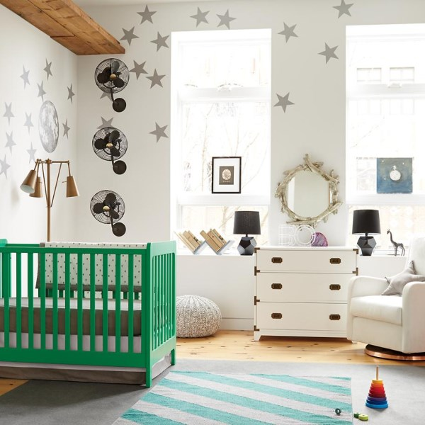Modern eclectic nursery with kelly green crib