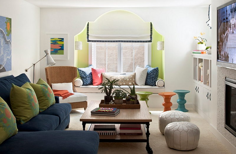 Moroccan Leather Poufs and colorful stools bring the Middle Eastern charm to the room