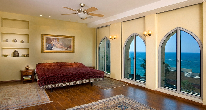 Moroccan style windows and fabric elevate the Mediterranean vibe of the beautiful bedroom