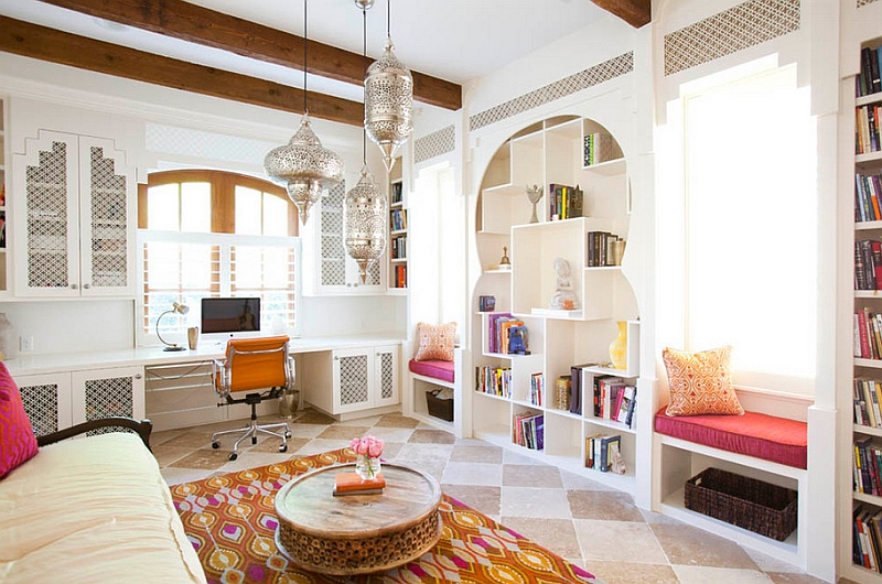 Multiple architectural details, curved doorways and Moroccan-inspired lights shape this living room