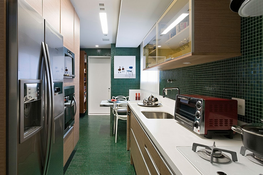 Narrow kitchen design idea with bright green tiles