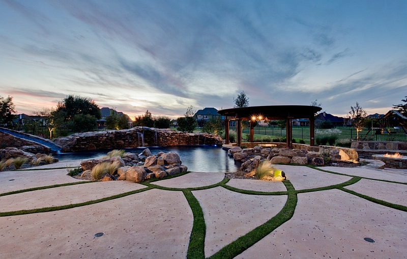 Natural style custom swimming pool with a tropical theme