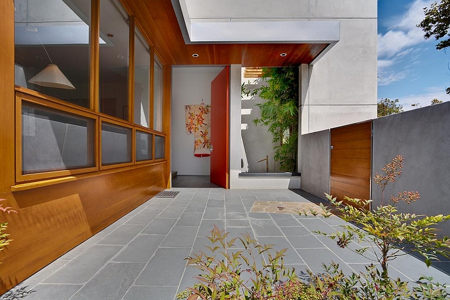 Natural wood siding complements the orange of the door perfectly!