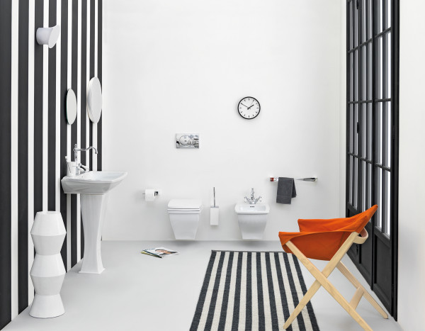 Orange accent chair looks captivating and fun in the cool black and white bath