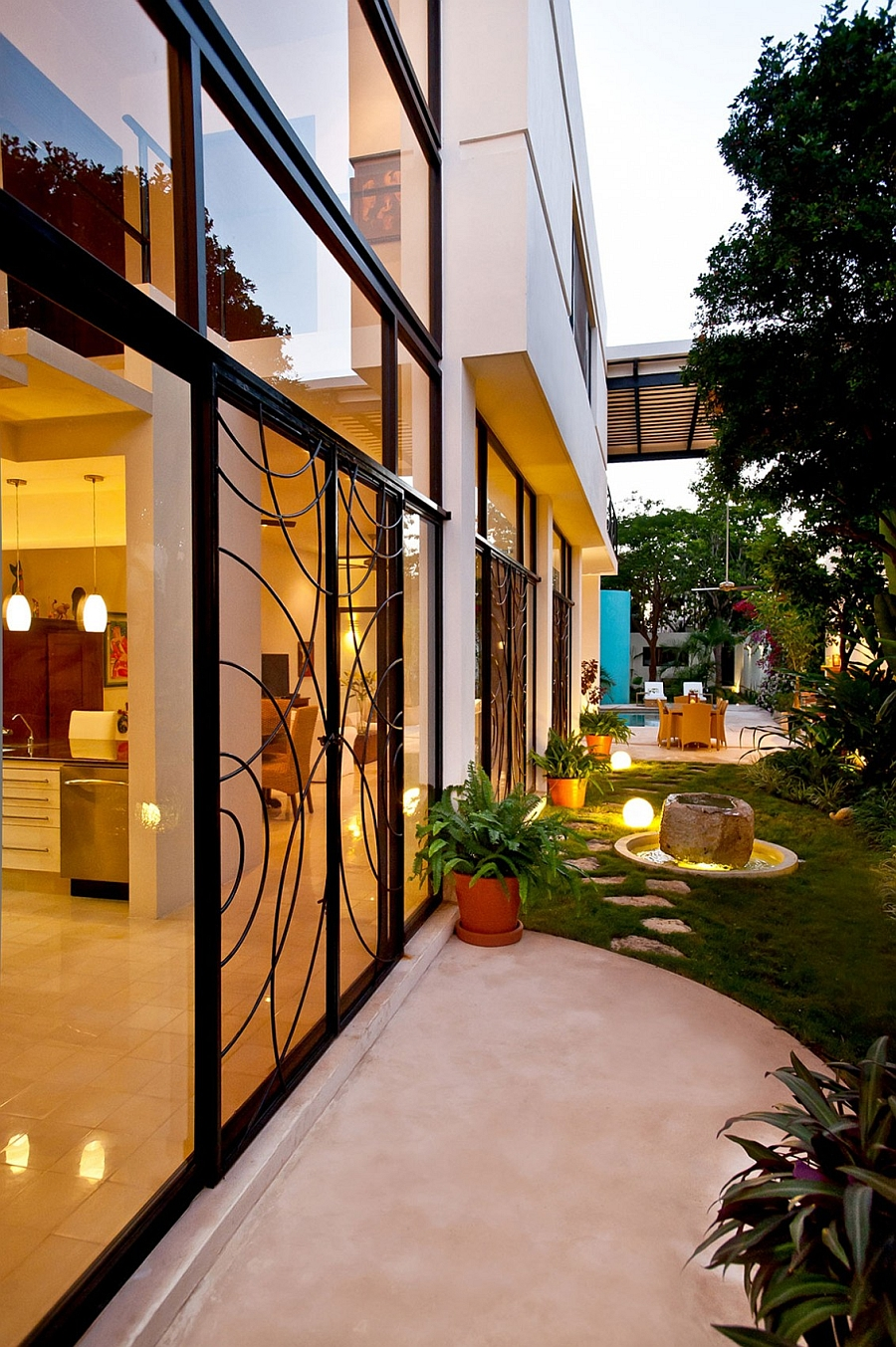 Outdoor lighting and intricate design on the sliding doors shape the beautiful landscape