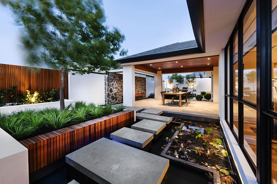 Outdoor water feature lends a tranquil appeal to the modern Perth home