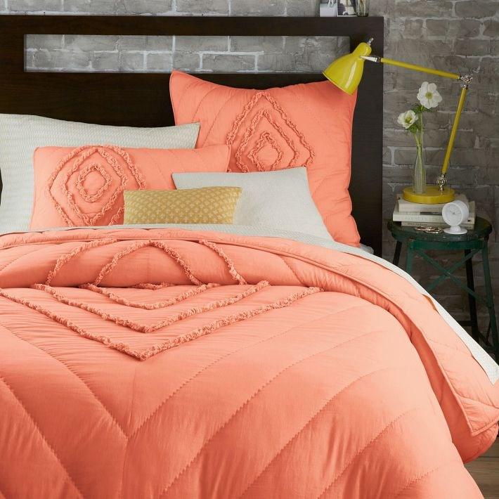 Peach bedding featuring diagonal lines