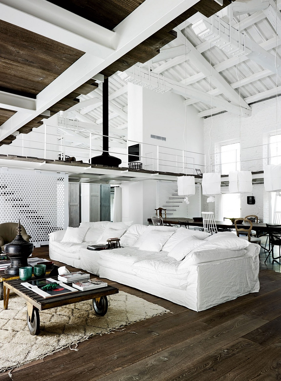 Plush couch in white fits in with the beautiful color palette of the gorgeous Italian home 200 Year Old Italian Factory Transformed Into An Enchanting Home With Industrial Charm
