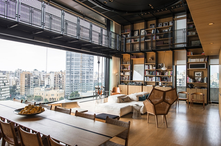 Plush decor and wooden walls bring warmth to the steely penthouse