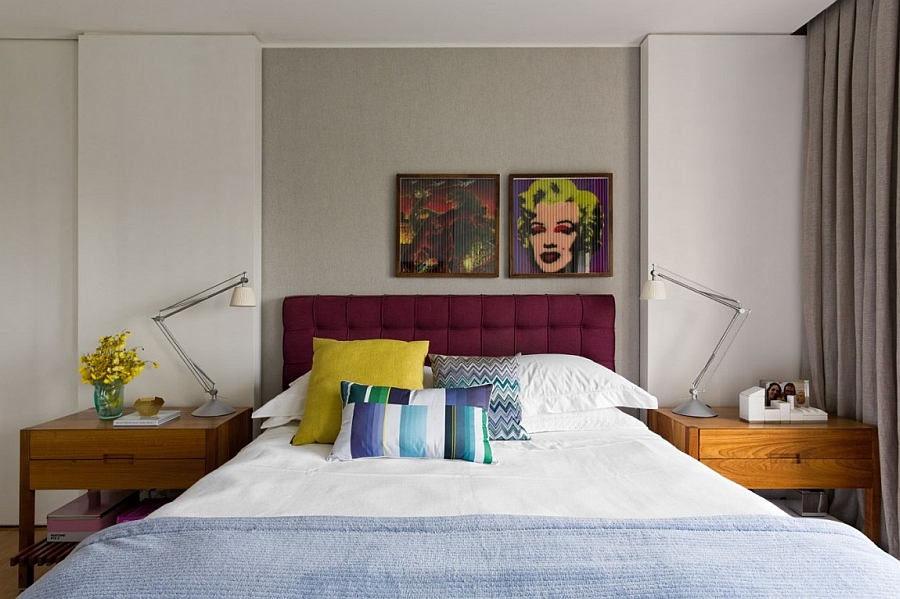 Plush headboard in purple and the portrait of Monroe add glam to the bedroom