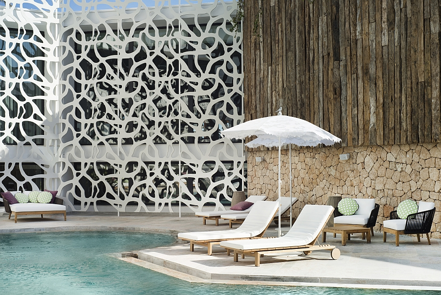 Poolside deck of the Hard Rock Hotel Ibiza with comfy Tribu Loungers