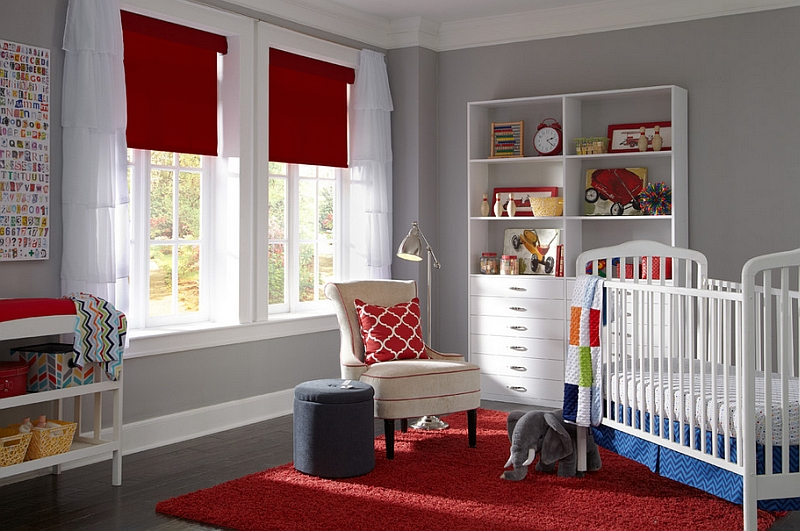 Red Roman shades and rug in the nursery keep the space elegant, simple and lively