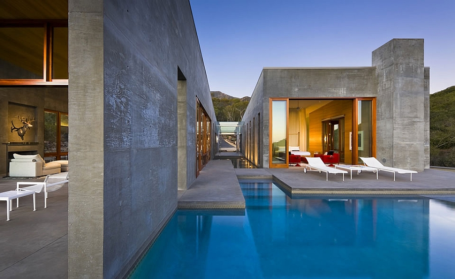 Refreshing pool outside the grand Toro Canyon house with a spacious deck
