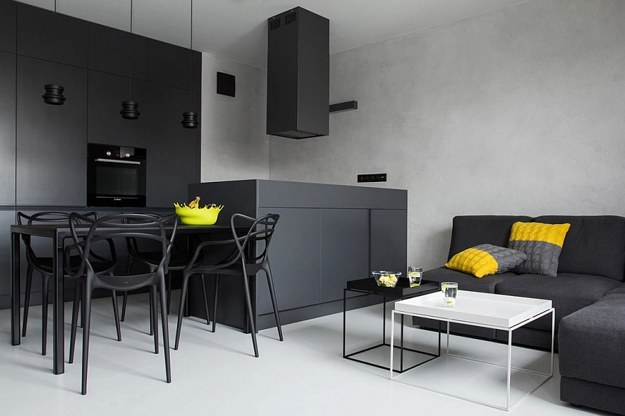Refreshing pops of yellow and green appear far more prominently when placed against a black and white backdrop Small Black And White Apartment In Poland Exudes Refined Minimalism