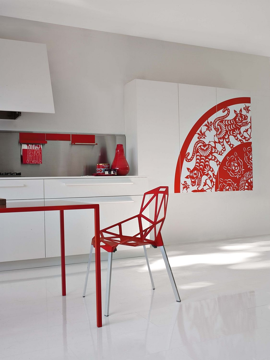 Sculptural decor additions and playful accents of red steal the show in this kitchen