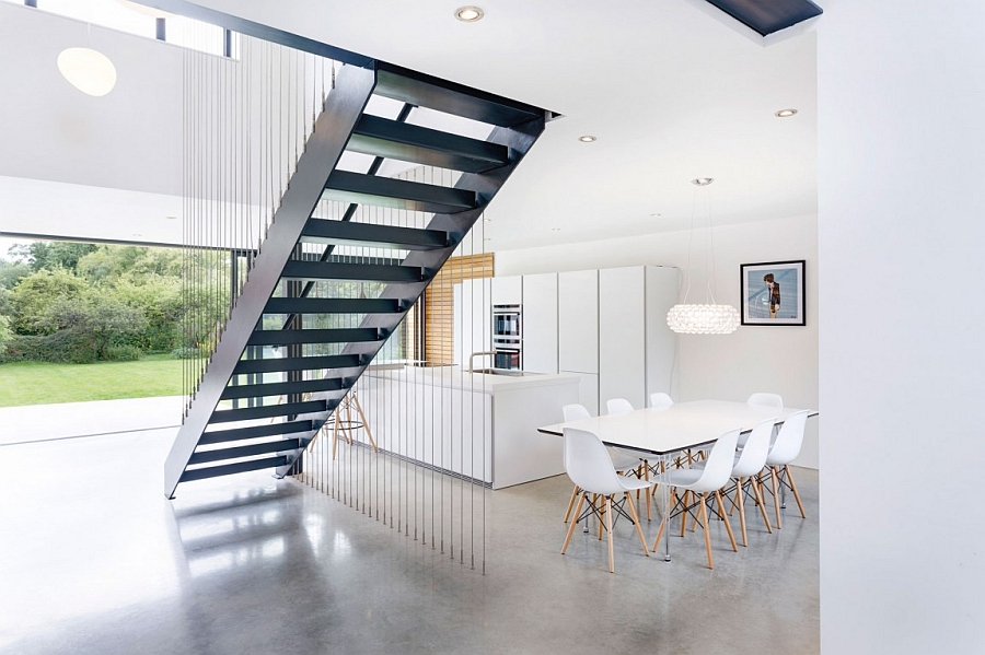 Sculptural staircase becomes the focal point of the lower level of Kilham House