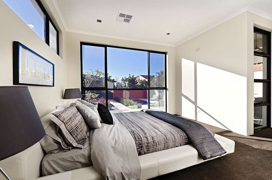 Serene and elegant bedroom in white with a viusally connectivity with the outdoors