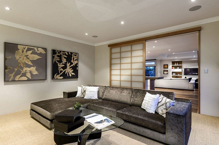 View in gallery Shoji screen-styled sliding doors seperate the living room  with the family
