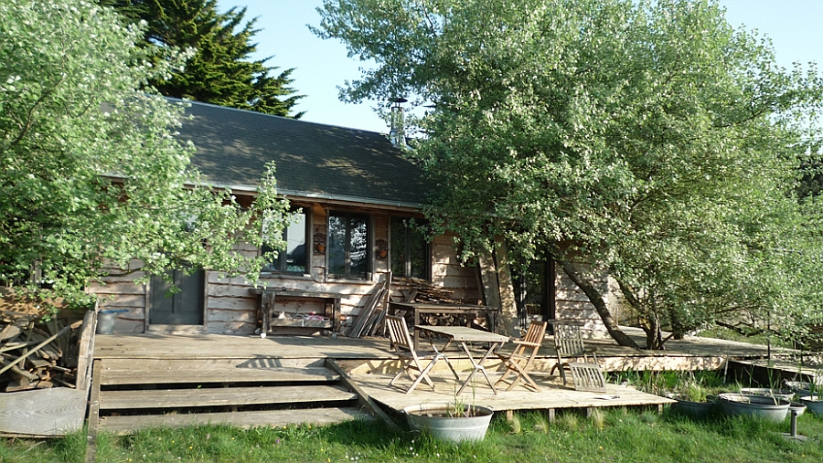 Simple and beautiful deck space of the rustic cabin in the woods Tiny Holiday Cabin In Normandy Charms With Its Disarming Rustic Goodness!