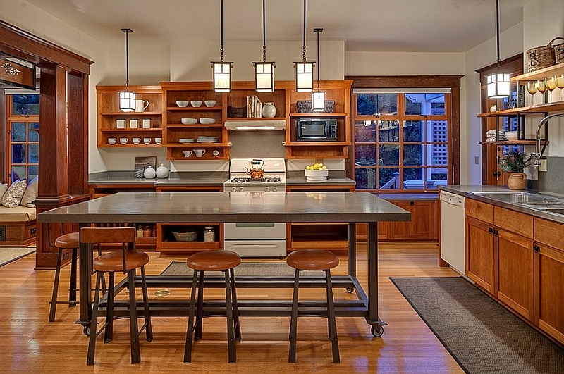 Simple color scheme, open shelves and the rolling kitchen island give the space an unassuming look