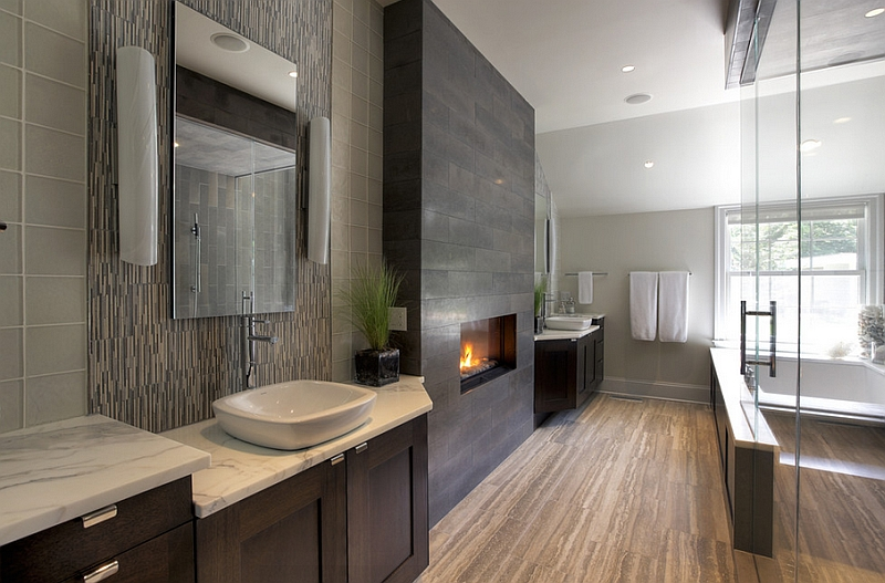 Sleek and polished bath with a fireplace at its heart