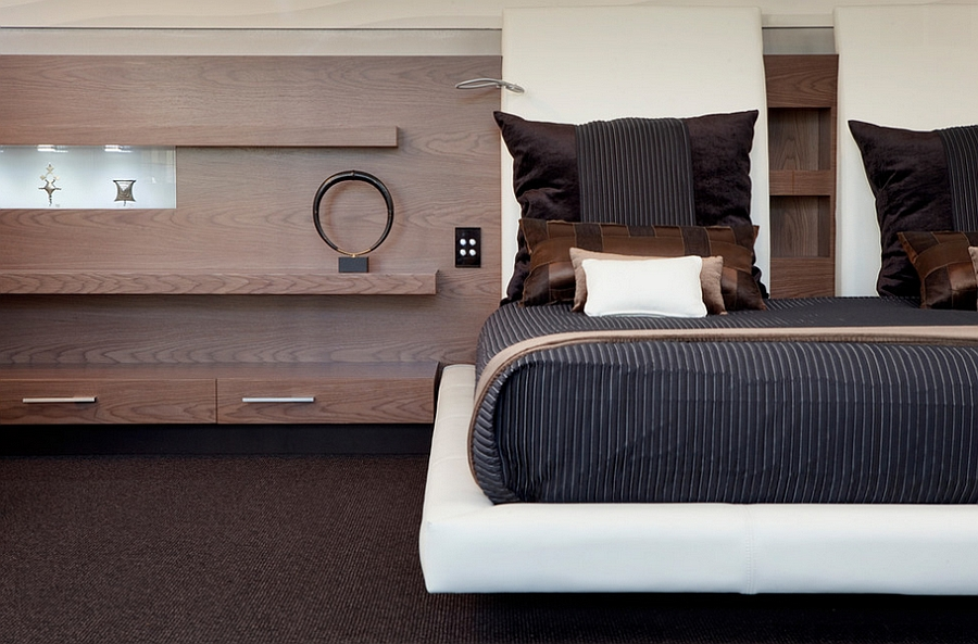 Sleek bedside additions and a cool platform bed give the room a more masculine vibe