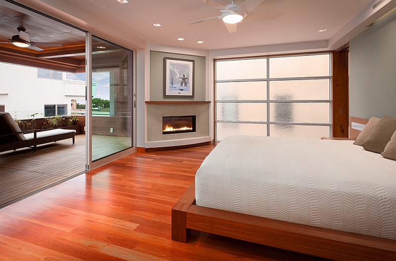 Sleek Corner Fireplace Adds Elegance To The Serene Bedroom