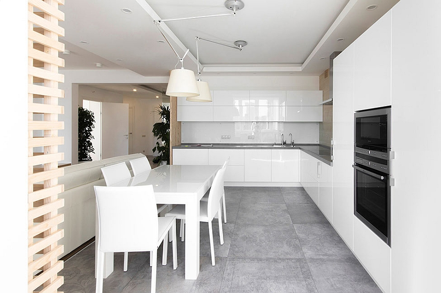Sleek, elegant kitchen and dining area in white
