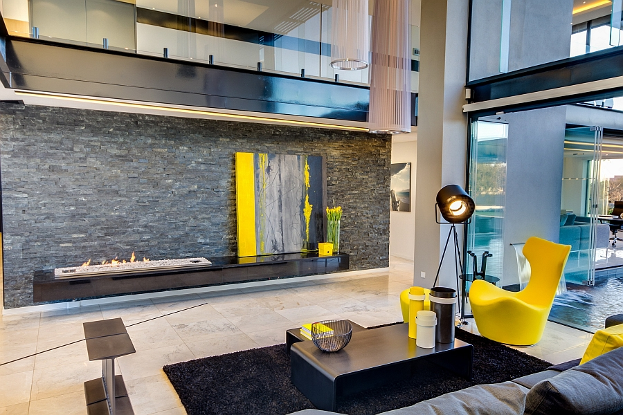 Sleek, modern fireplace and casually placed wall art lend sophistication to the room