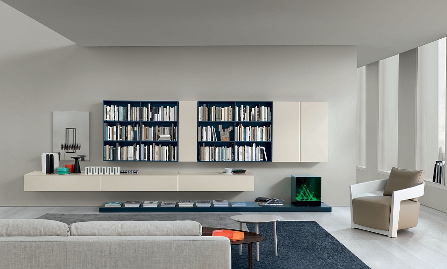 Sleek wall units in white offer ample display and storage space in the living room