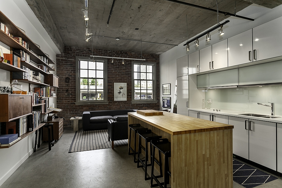 Small and elegant living space and kitchen of the renovated Vancouver Loft Historic Loft Brings Together Rich Heritage And Contemporary Comfort