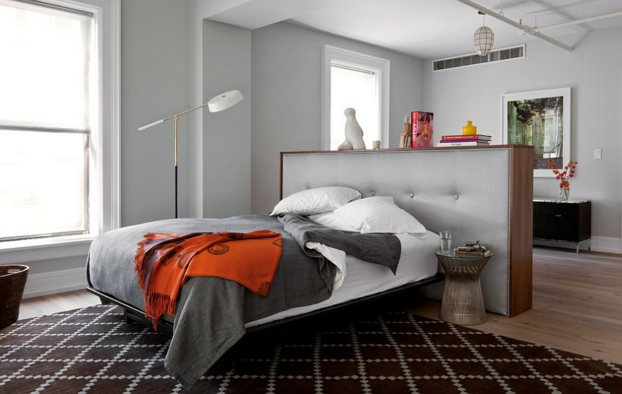 Small partition wall also acts as a beautiful tufted headboard in the bedroom
