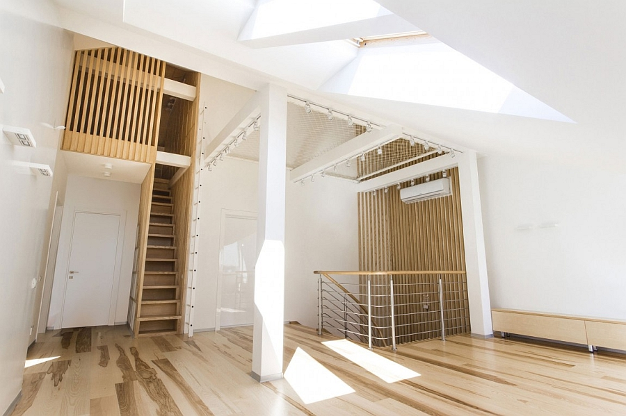 Smart niches help maximize the floor space of the attic apartment