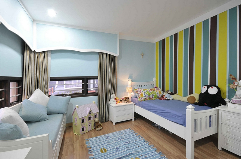 Smart striped wall makes the kids' bedroom seem larger