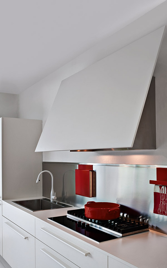 Space-saving kitchen cabinets that dissapear into the wall
