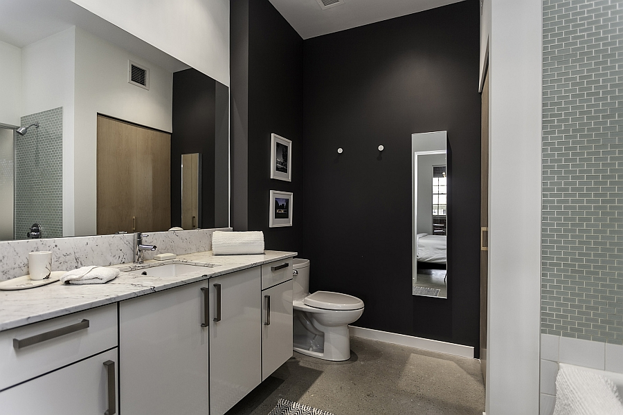 Spacious contemporary bath in black and white with a vanity that offers plenty of storage