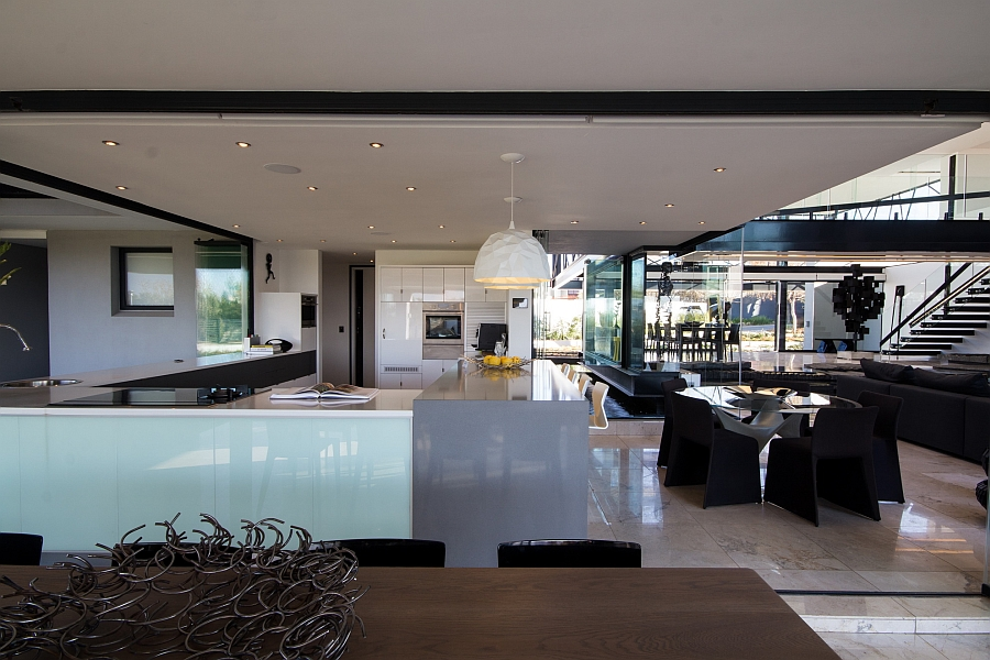 Spacious dining area and kitchen complement the glamorous living room perfectly