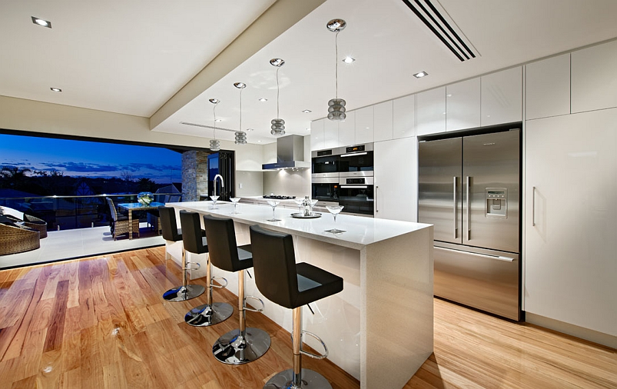 Spacious kitchen in white with a lovely island and smart seating