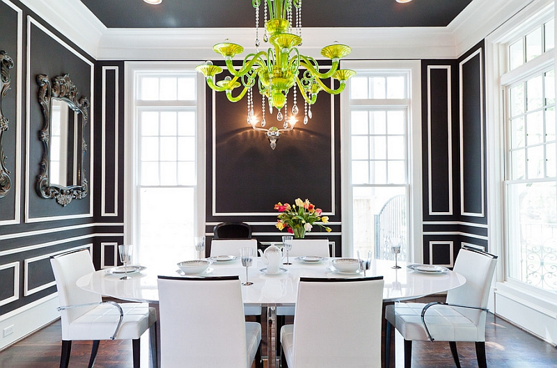Sparkling chandelier becomes even more evident thanks to the black and white backdrop